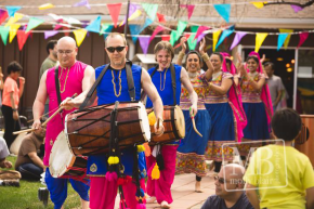 Marching into the performance for a Holi party. Photo credit: http://www.mollyblairphotography.com/